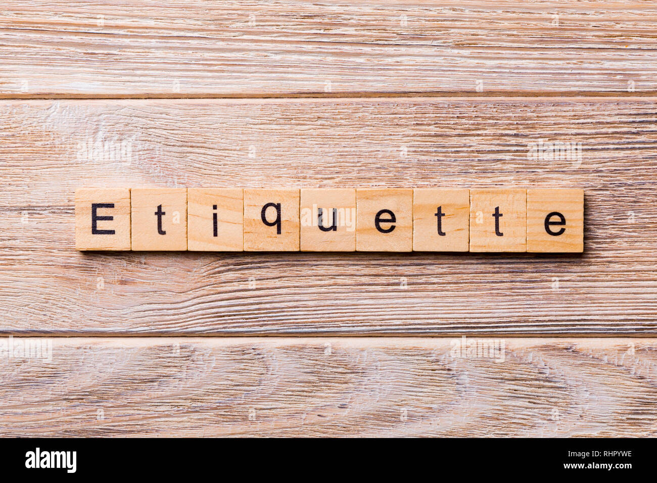 ETIQUETTE word written on wood block. ETIQUETTE text on wooden table for your desing, concept. - Stock Image