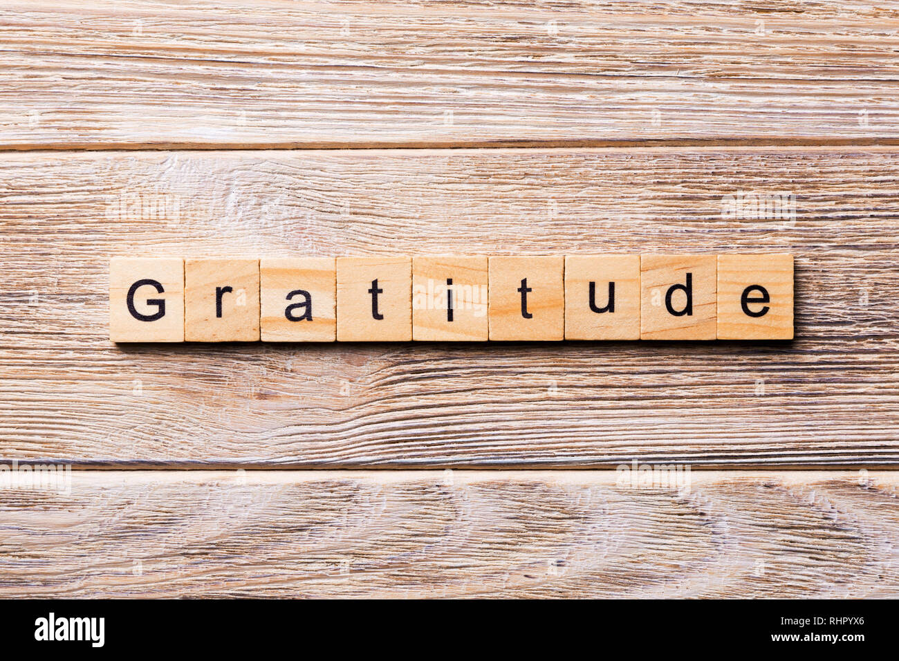 gratitude word written on wood block. gratitude text on wooden table for your desing, concept. - Stock Image