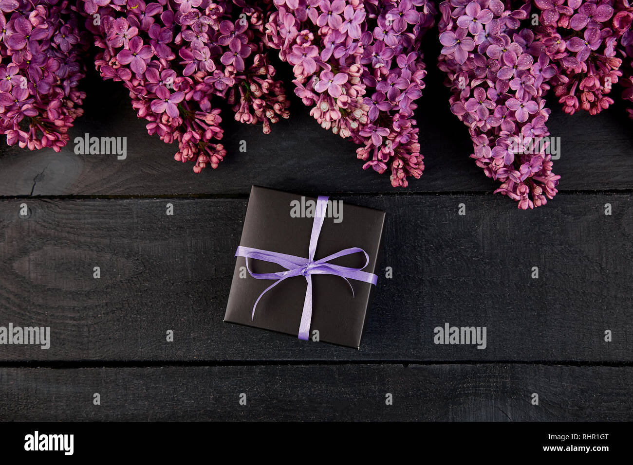 969efdd81519e Black small gift boxes wrapped with violet