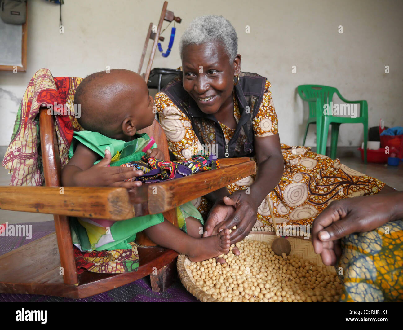 TANZANIA  -  Sean Sprague photo 2018  Physio-therapy workshop for children with special needs, Mabatini, Mwanza. 1-year-old baby girl suffers from cerebral palsy here assisted by Natalia Kadio, project coordinator. Stock Photo