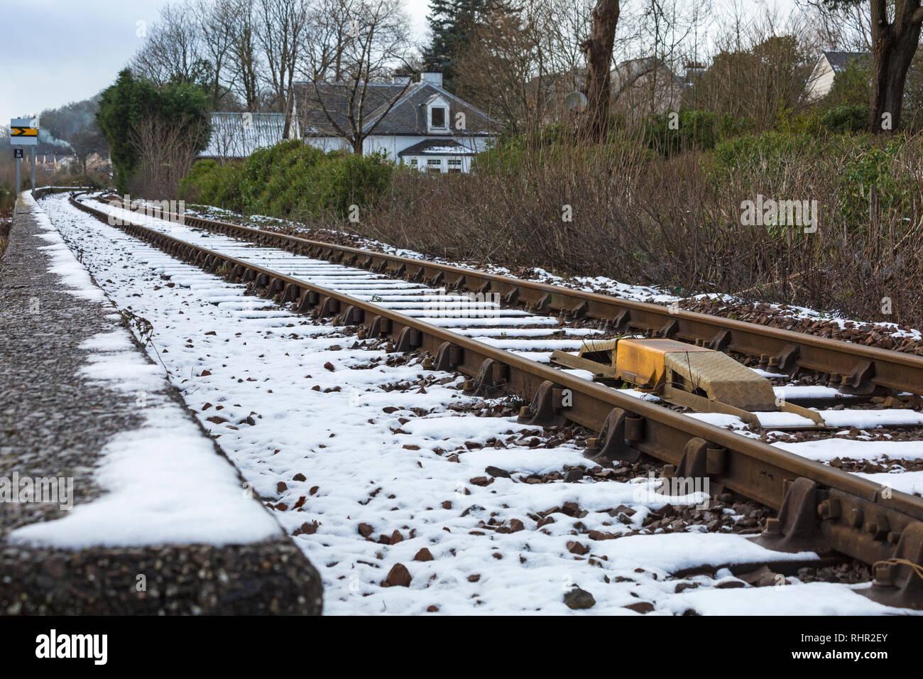 Snow on the railway tracks at Corpach, Fort William, Scotland in winter - railway track, rail track tracks, train tracks, railroad tracks - Stock Image