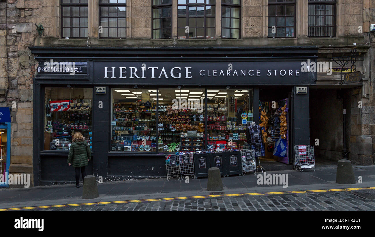 Heritage Clearance Store nestles in Edinburgh's famous High Street. Selling kilts,sporrans,ghillie shirts,tarten trousers, sgian dubhs and Clan items. Stock Photo