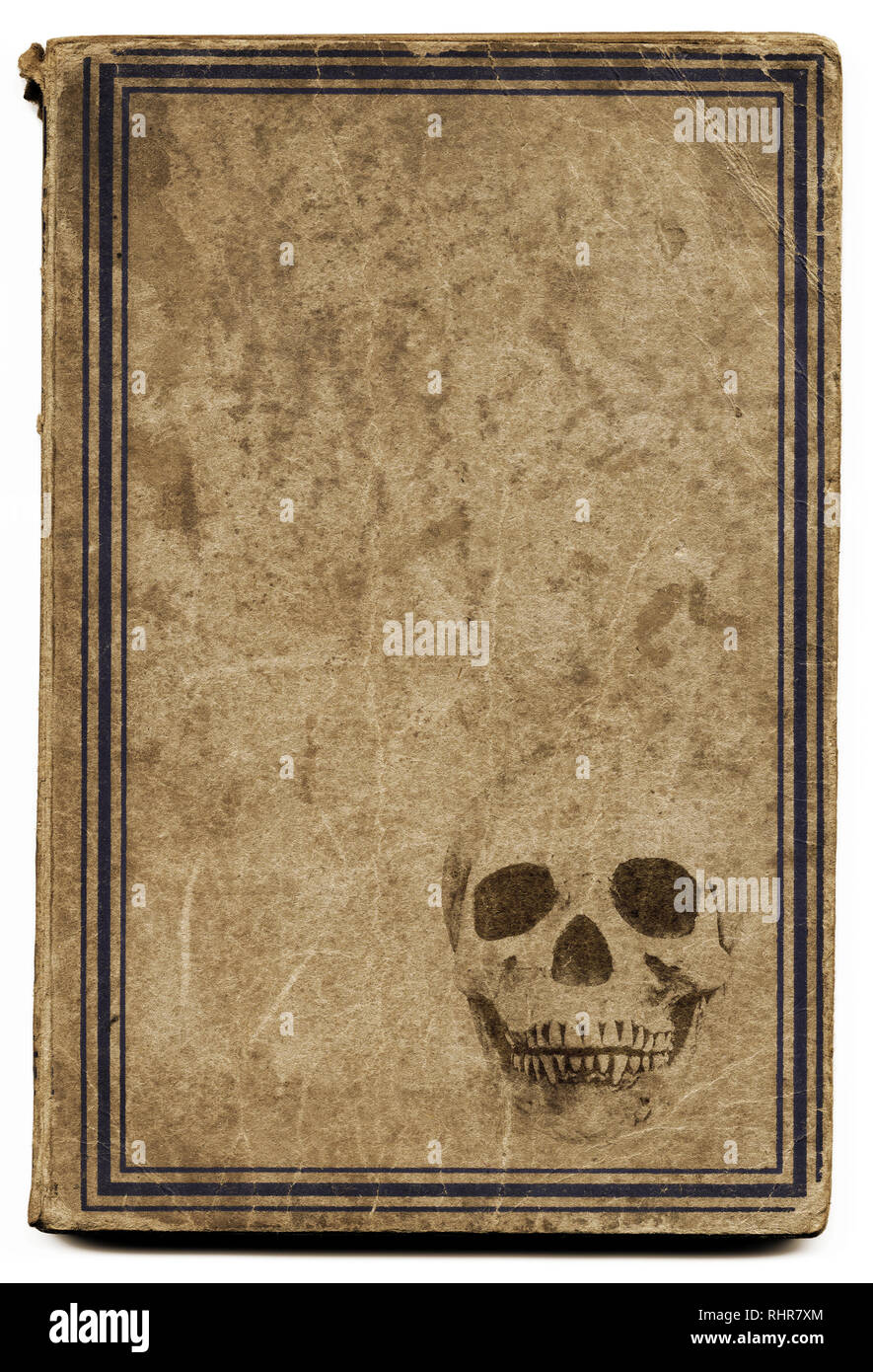 Very old brown book with framed cover with a stamped skull with plenty space for title such as witchcraft, etc... Good image for halloween. - Stock Image