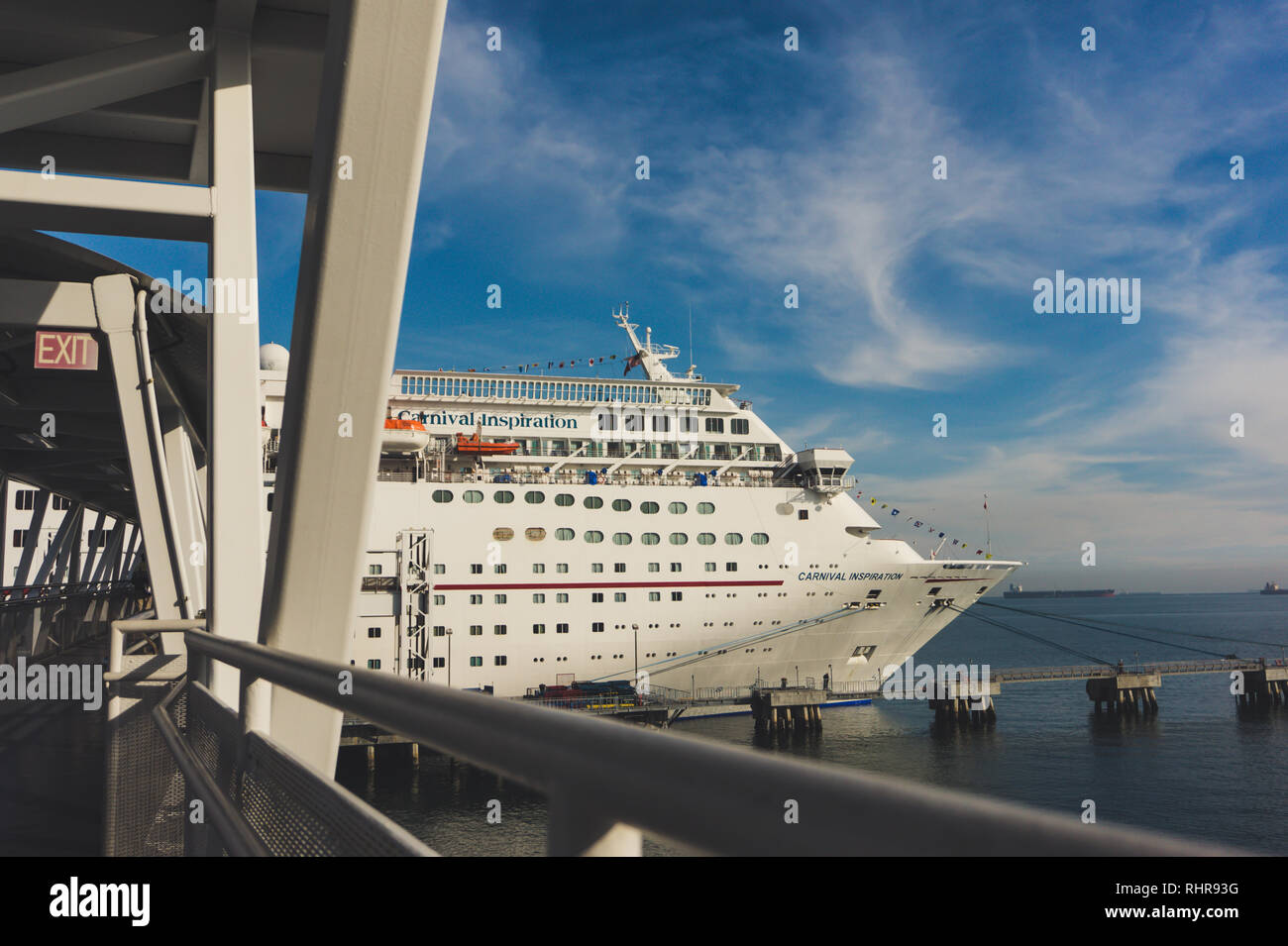 The Carnival cruise ship 'Inspiration' in port in Long Beach on a beautiful sunny day with blue skies- includes the ramp to board the boat - (embark) - Stock Image