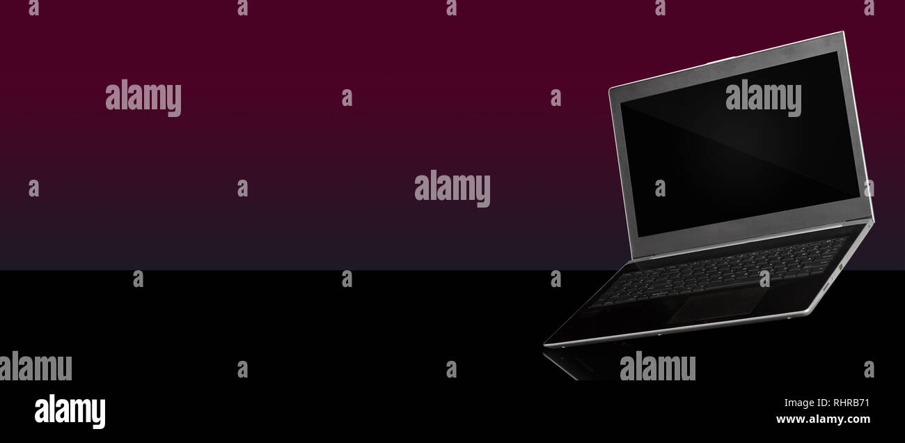 Side View of a hanging Laptop on blank banner template Stock Photo