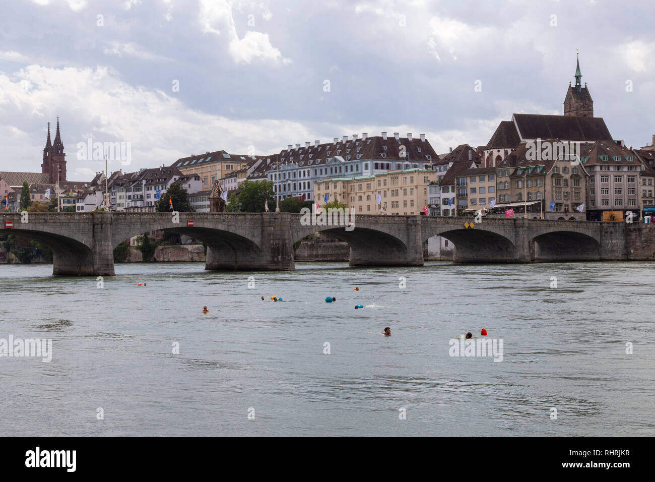 In Basel, it is customary to swim down the Rihn river on hot summer days, get into the water between the Wettsteinbrücke and Johanniterbrücke bridges - Stock Image