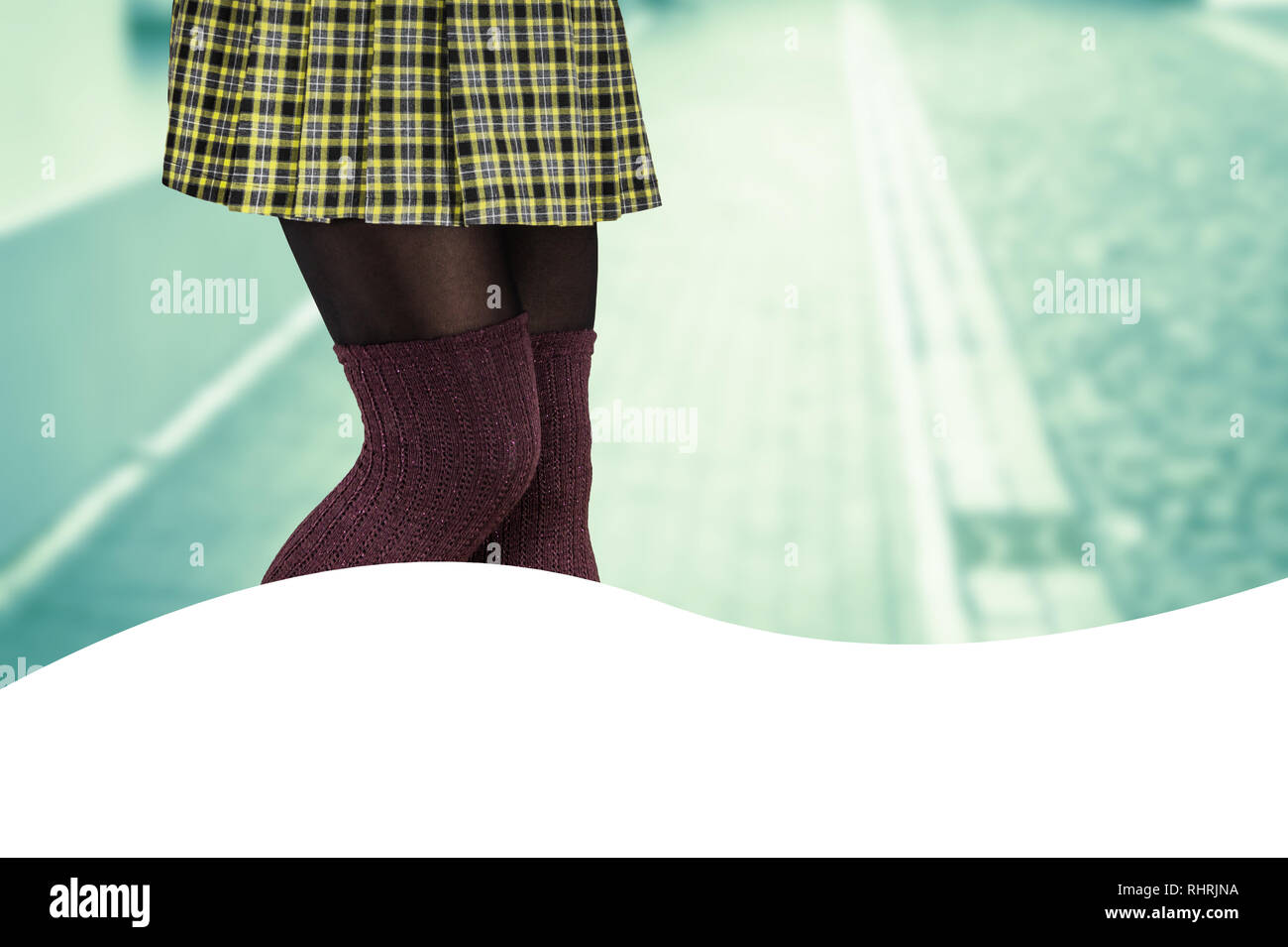d8a8b64585d Woman with beautiful legs wearing mini skirt and knee high socks - Stock  Image