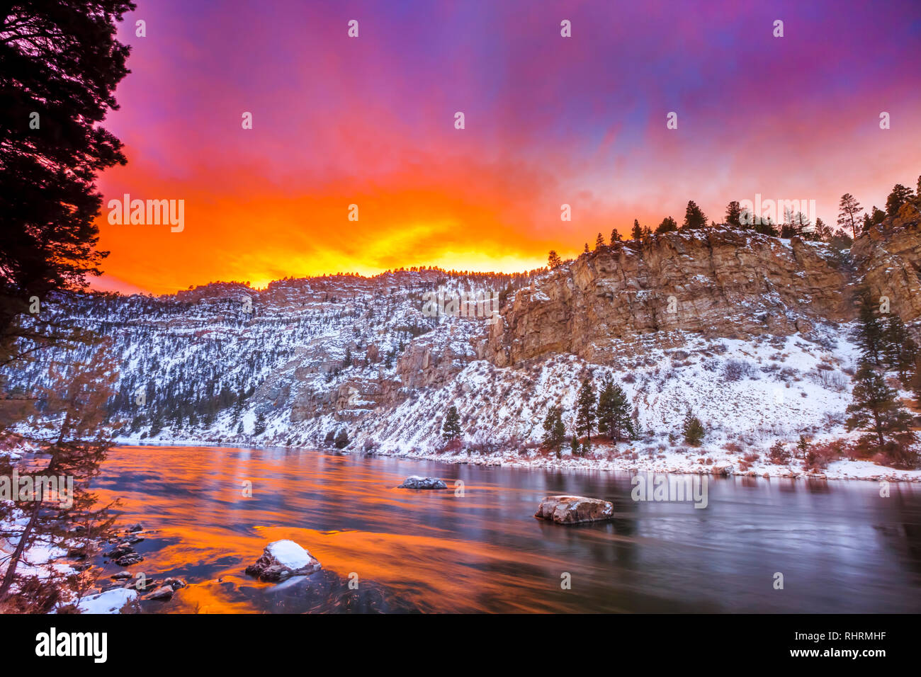 sunset over the missouri river in a canyon below hauser dam near helena, montana - Stock Image