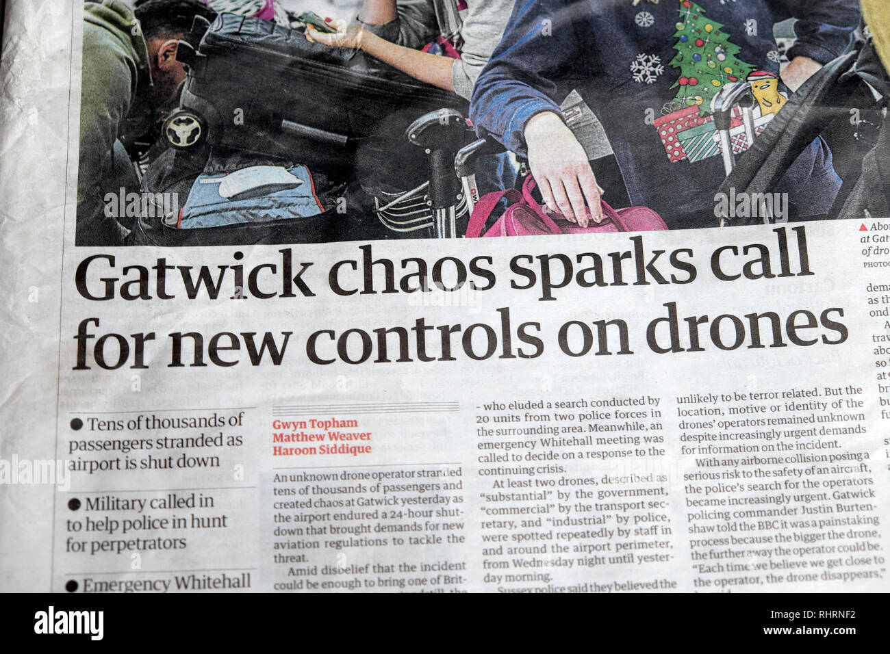 'Gatwick chaos sparks call for new controls on drones' Guardian front page newspaper headline at Christmas in London UK 21 December 2019 - Stock Image
