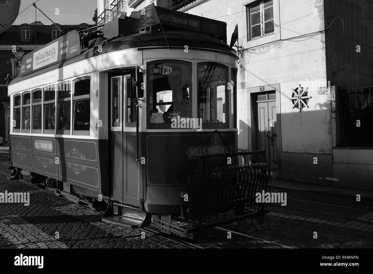 Traditional Brightly Coloured Lisbon Tram in Alfama District Lisbon Portugal Europe - Stock Image