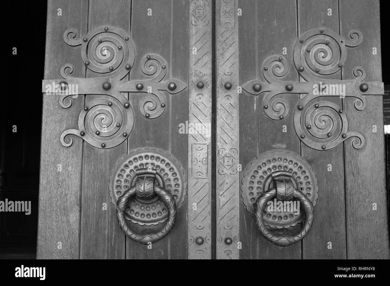 Lisbon Cathedral Ornate Medieval Doors Spiral Hinges and Hooped Handles Santa Maria Major Alfama Area Lisbon Portugal - Stock Image
