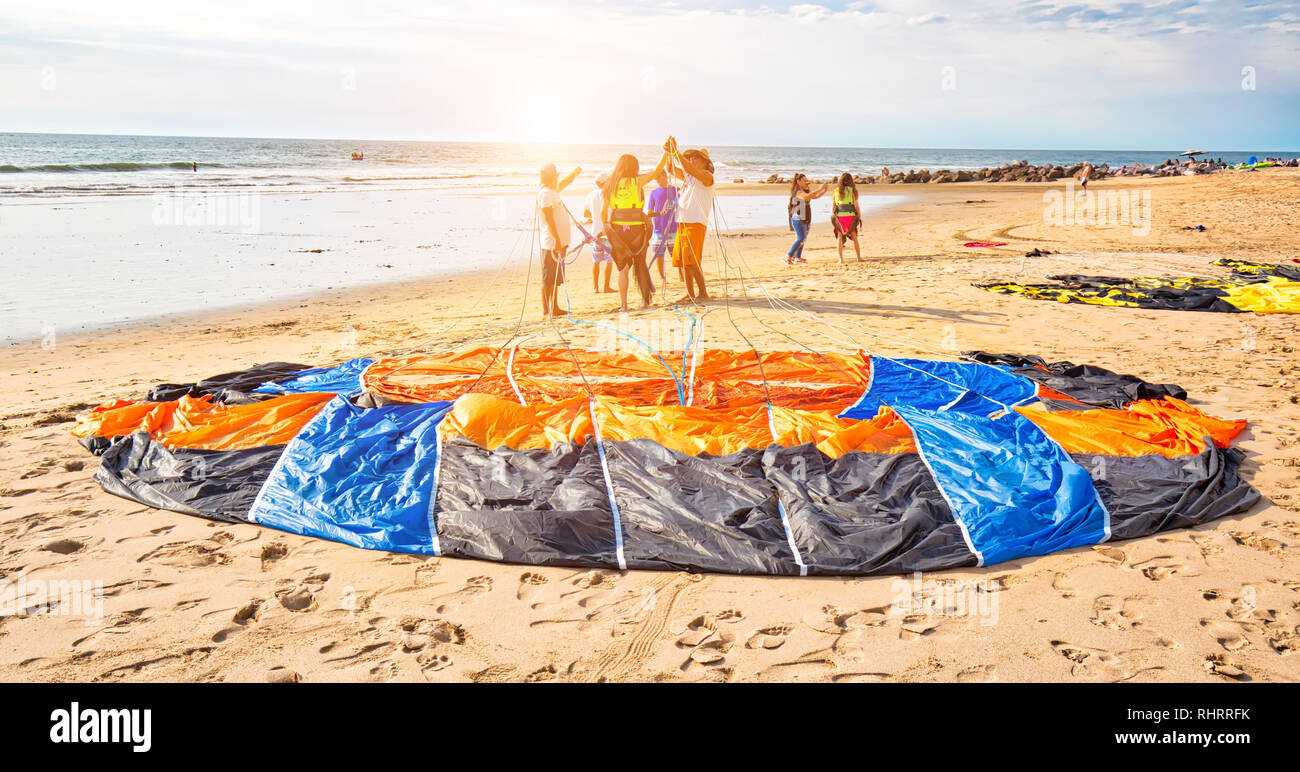 Mazatlan, Mexico-10 December, 2018: A group of diverse young men learning kite surfing in Golden Zone (Zona Dorada), a famous touristic beach and reso Stock Photo