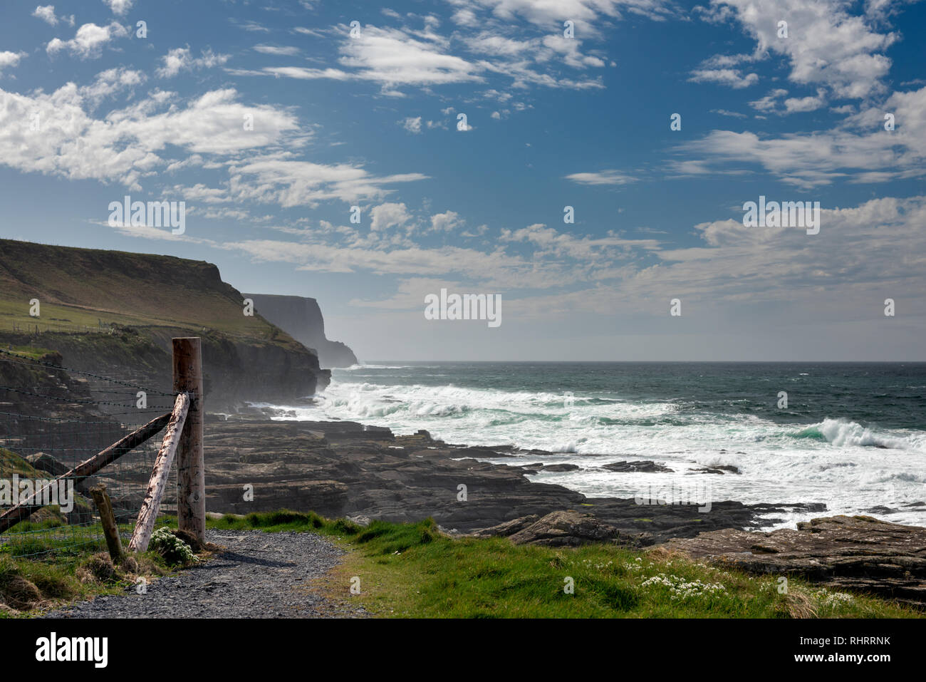 Cliffs of Moher coastal trail seascape. Footpath along the Atlantic Ocean west coast Ireland. Dramatic scenic view on the Wild Atlantic Way. - Stock Image