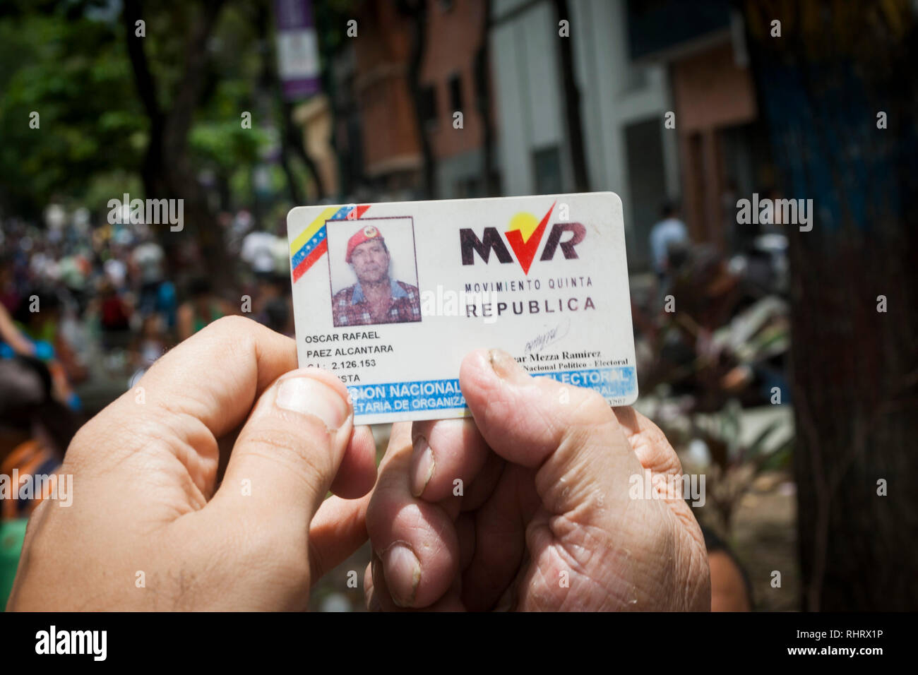 Caracas, Dtto Capital / Venezuela - 03/05/2013. Man showing his card that accredits him as a member of the MVR party. - Stock Image