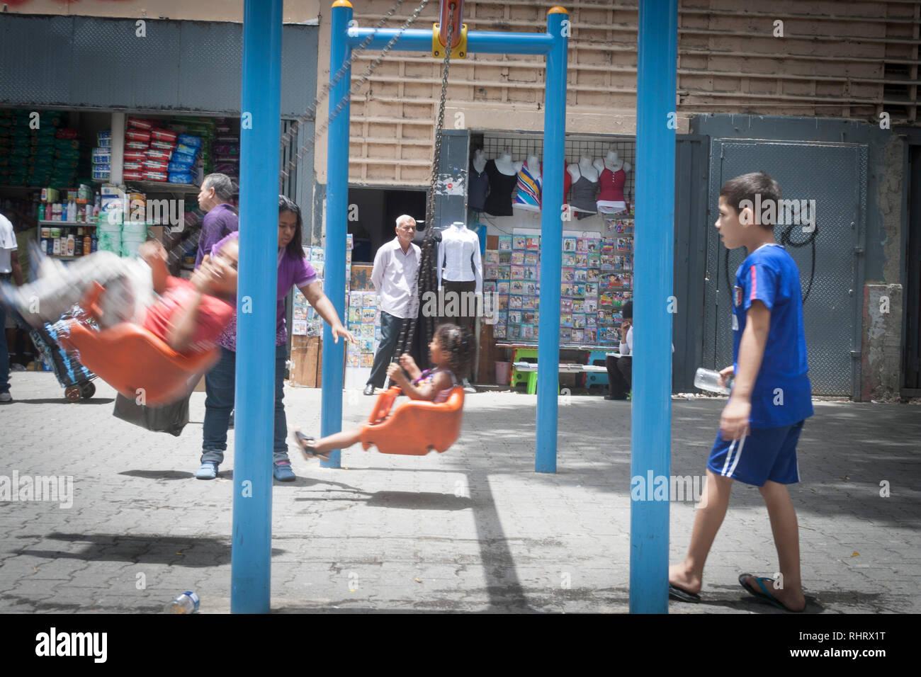 Caracas, Dtto Capital / Venezuela - 03/05/2013. Children enjoying games on the boulevard of Catia. - Stock Image