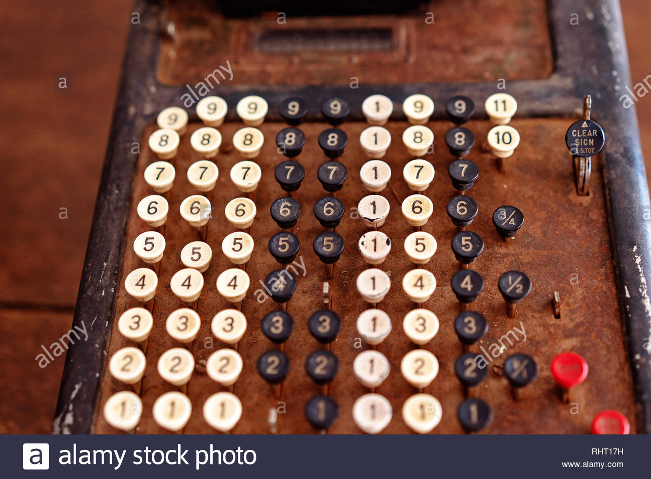 Vintage calculator used for adding numbers in the old days of yesteryear - Stock Image