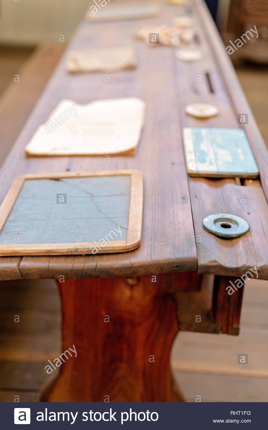 Vintage wooden student form desk with inkwell and slate as used in a school room in yesteryear - Stock Image