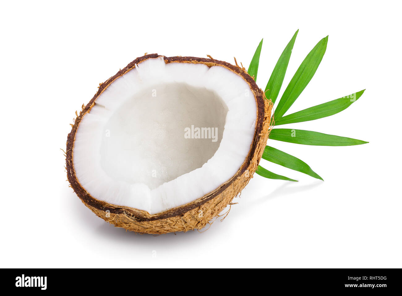 half of coconut with leaves isolated on white background - Stock Image