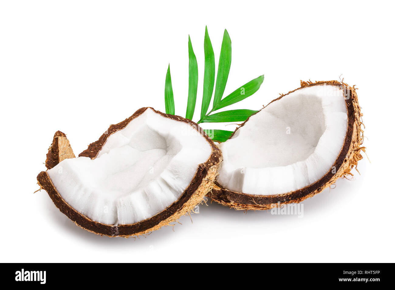piece of coconut with leaves isolated on white background - Stock Image