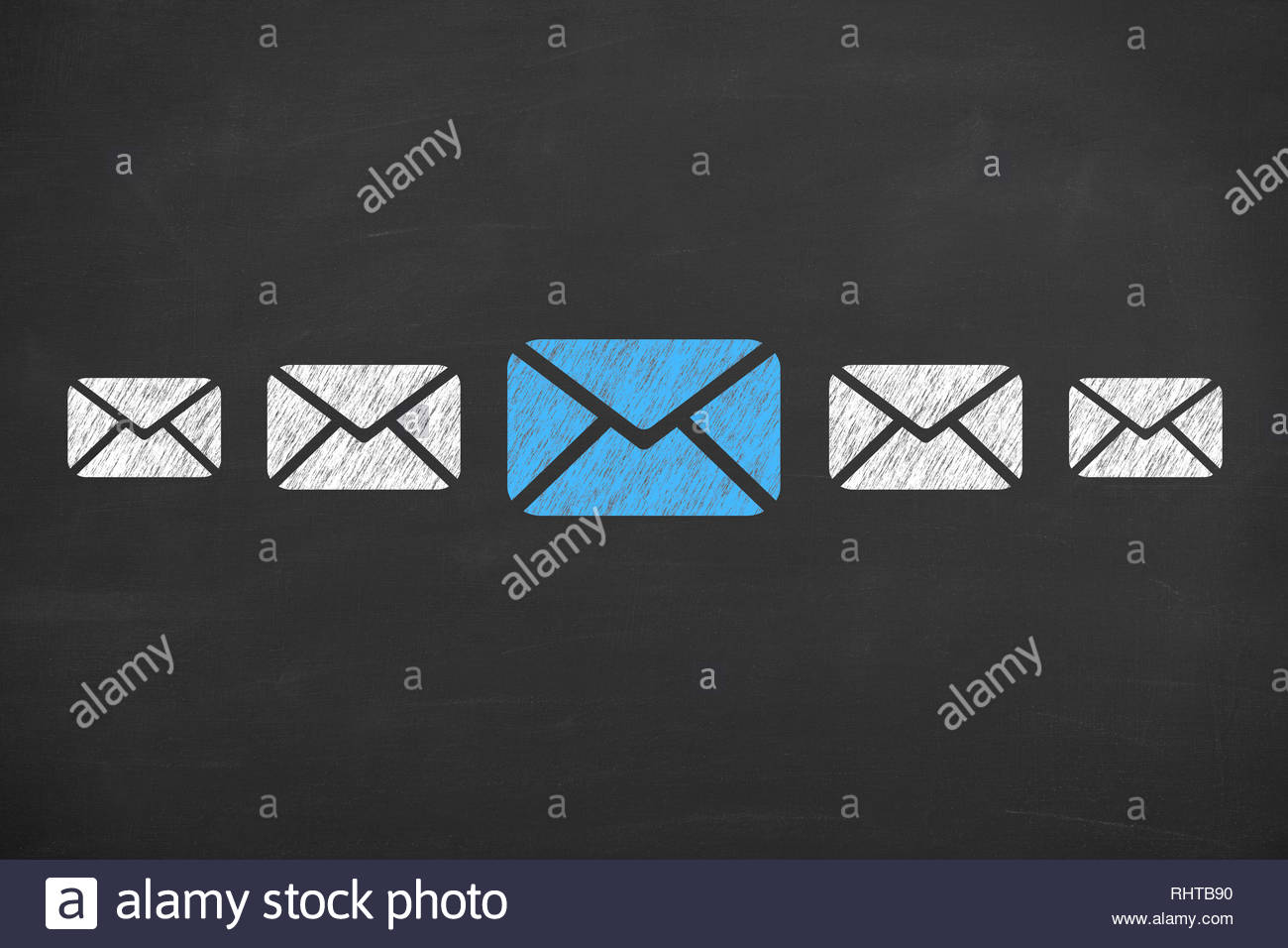 Email concepts on blackboard background - Stock Image