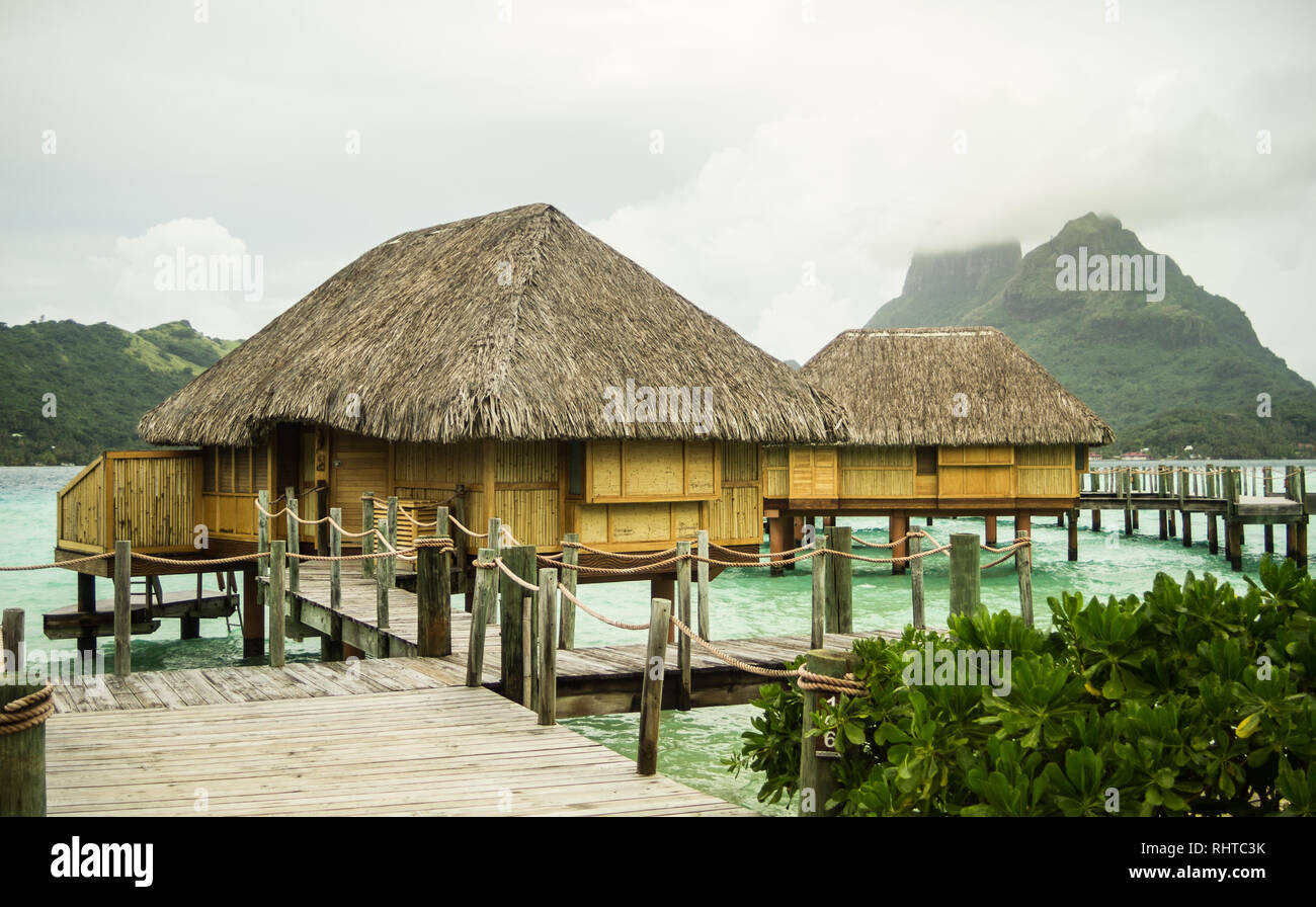 View Of The Over Water Bungalows At Pearl Beach Resort In