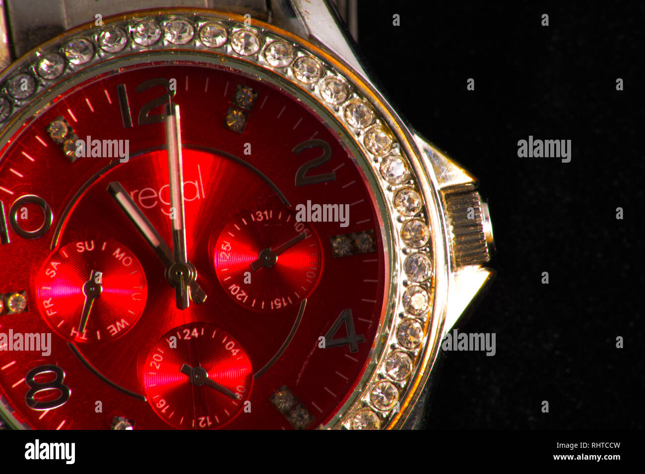 Red watch face multiple dials - Stock Image