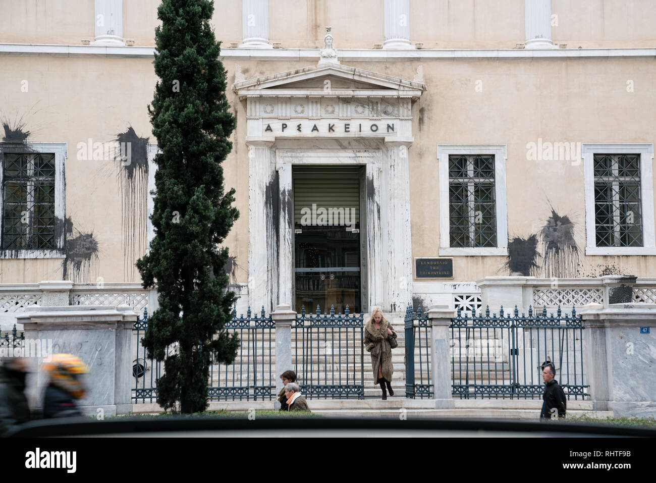 The building of the Arsakeion in Athens, where the Council of State is seated with black paint thrown onto it in protest against further austerity cut - Stock Image