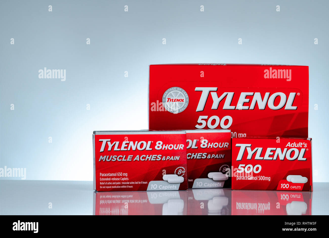CHONBURI, THAILAND-OCTOBER 27, 2018 : Tylenol 500 mg and Tylenol 8 hour 650 extended-release caplets in red packaging on gradient background. Drug for - Stock Image