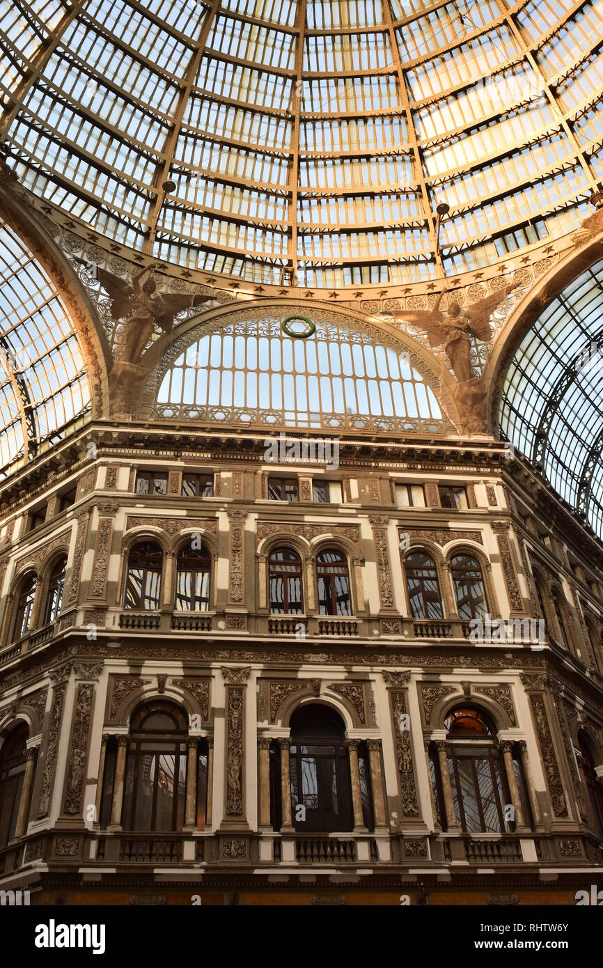 Building and gigantic glass ceiling with two angels and cupola of Galleria Umberto in Naples. Stock Photo
