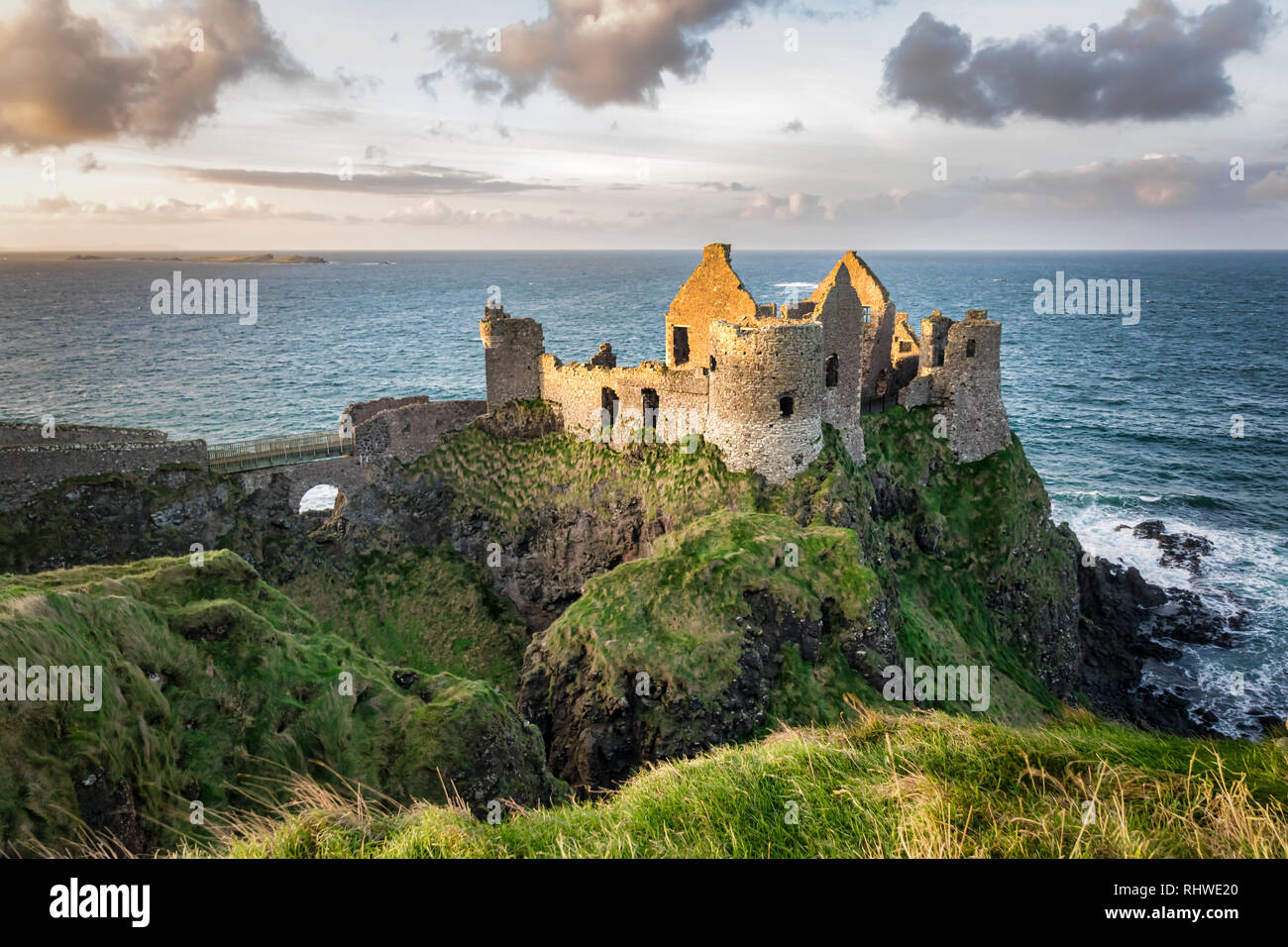 This is a picture of the ruins of Dunluce Castle in Northern Ireland.  It was built in the 13th century on the top of a sea cliff looking out to the A - Stock Image
