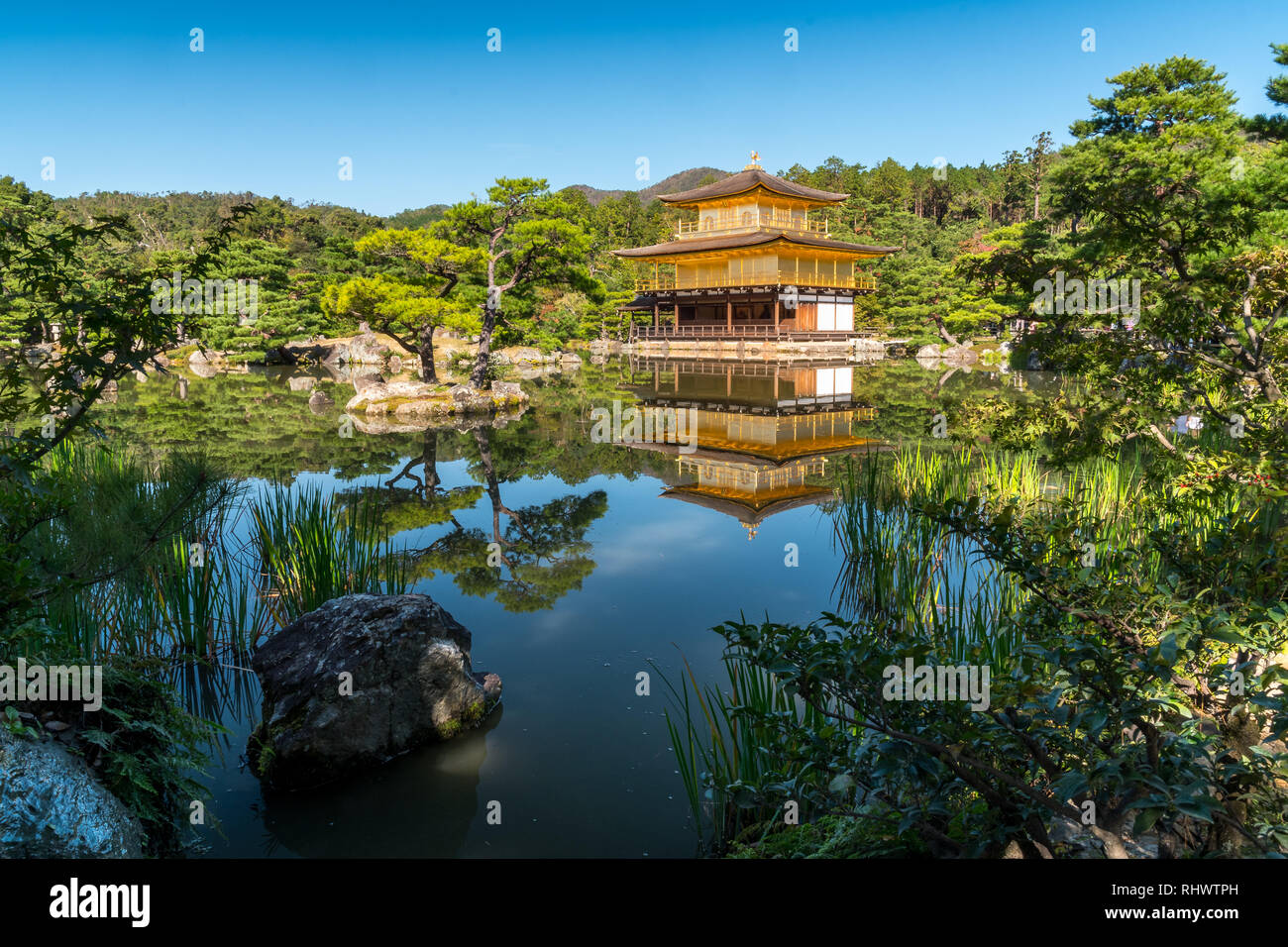 Golden Temple of Kinkaku-ji with reflection in pond in Kyoto - Stock Image