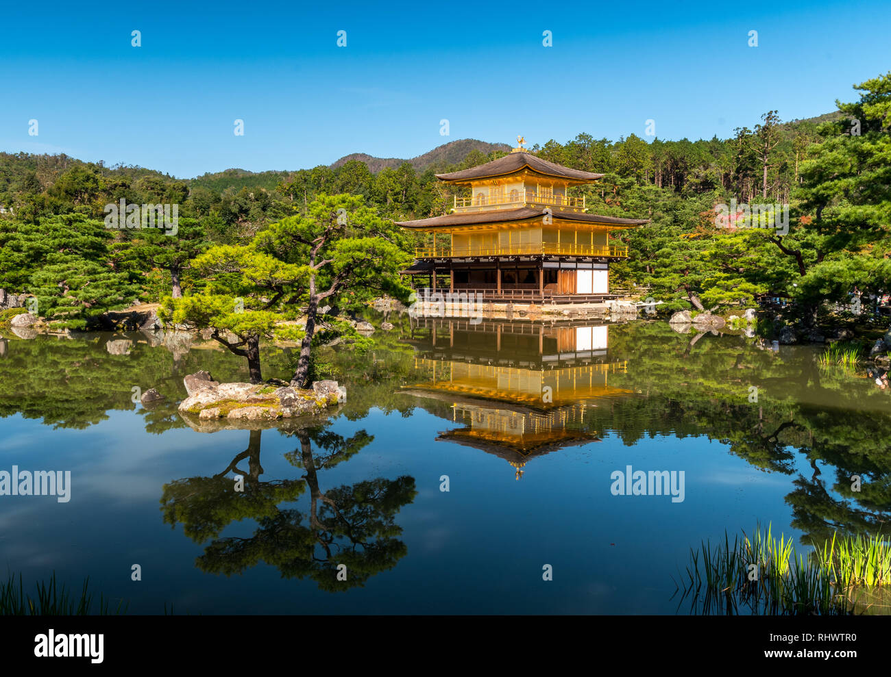 Kinkaku-ji, is a Zen Buddhist temple in Kyoto, Japan. It is one of the most popular buildings in Japan, attracting a large number of visitors annually - Stock Image