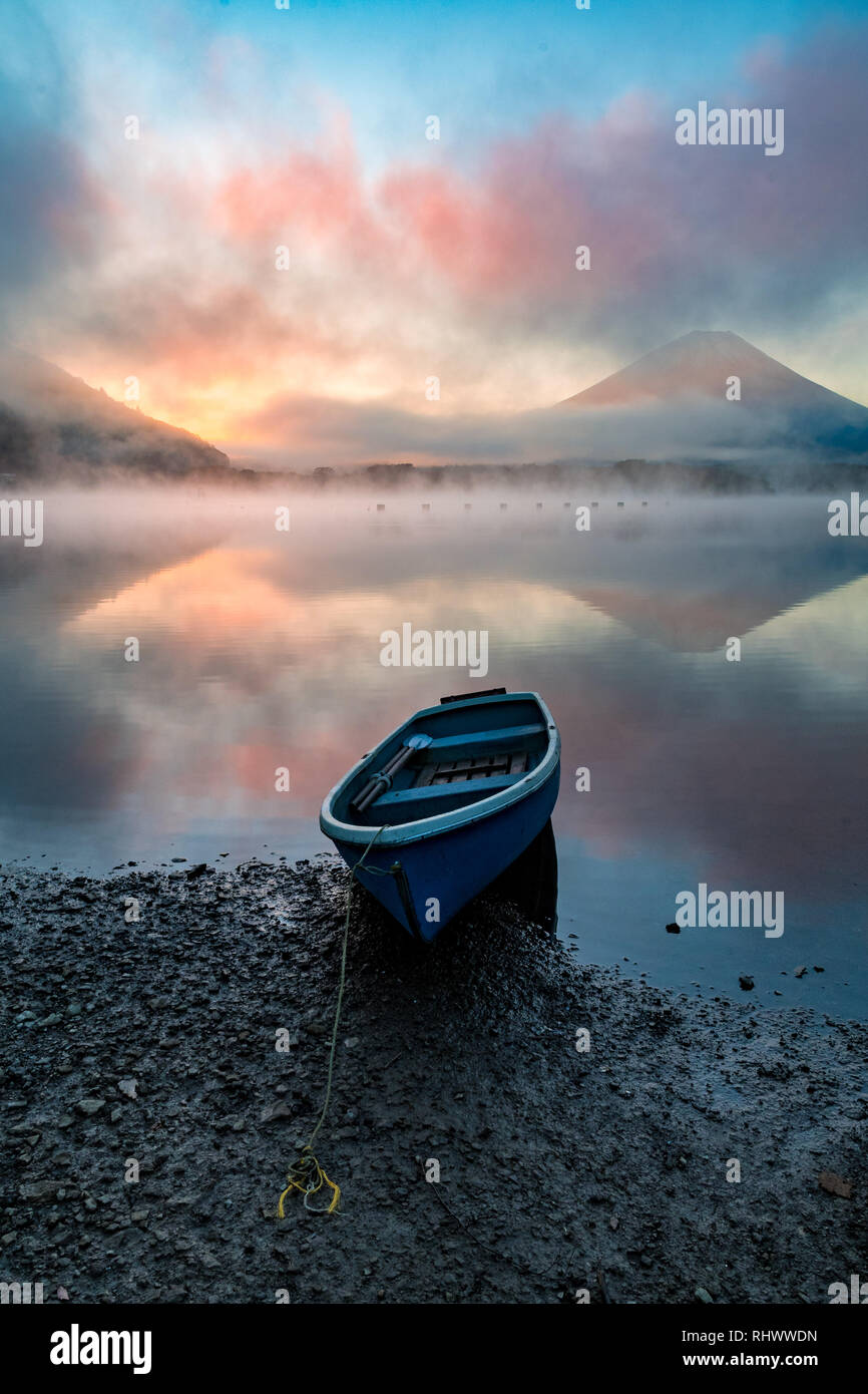 the boat and mount fuji on a misty moring at Lake Shoji - Stock Image