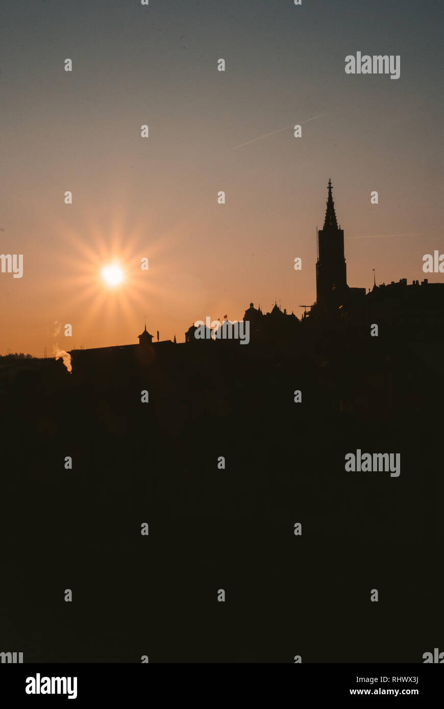 Silhouette of Berner Münster and the Oldtown of Bern at Sunset - Stock Image