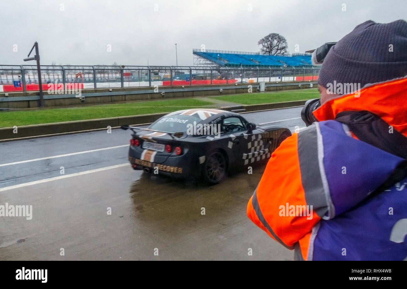 Silverstone, Northamptonshire. 4th Feb 2019. Veterans and family members  enjoy the fast cars, on the starting grid McLaren, Porsche, Mercedes, Audi  at the International Super Sports Car  Circuit part of the mission motorsports event. Credit: Clifford Norton/Alamy Live News - Stock Image