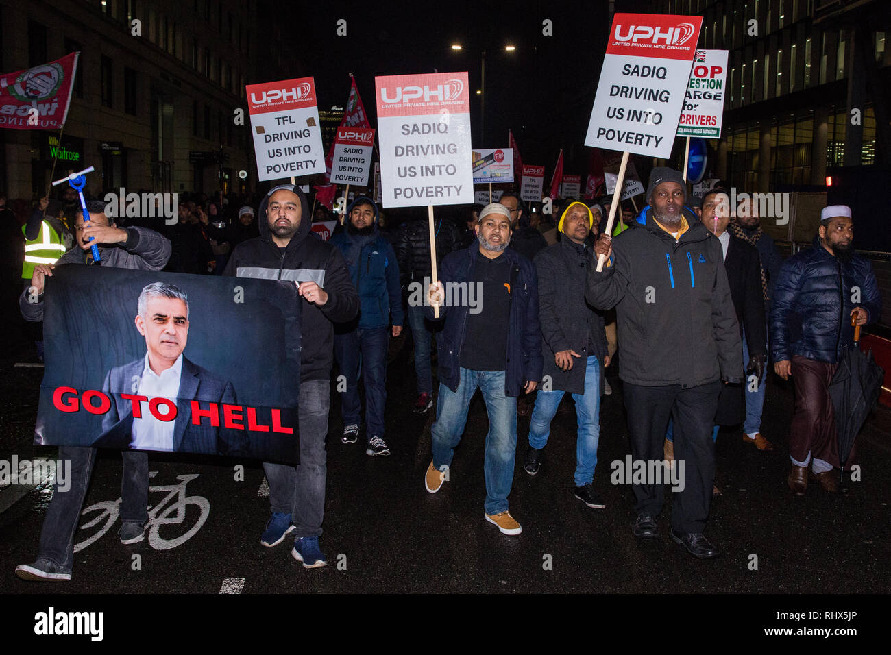 London, UK. 4th February, 2019. Hundreds of minicab drivers block London Bridge as part of a protest organised by the United Private Hire Drivers (UPHD) branch of the Independent Workers Union of Great Britain's (IWGB)  following the introduction in December of congestion charges for minicabs. Credit: Mark Kerrison/Alamy Live News - Stock Image