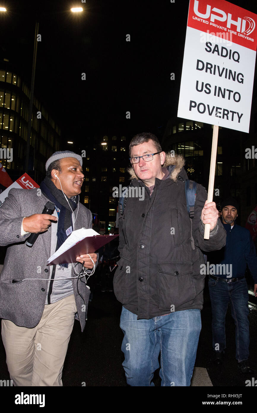 London, UK. 4th February, 2019. James Farrar, Chair of the United Private Hire Drivers (UPHD) branch of the Independent Workers Union of Great Britain (IWGB) joins hundreds of minicab drivers blocking London Bridge in protest against the introduction of congestion charges for minicabs. Credit: Mark Kerrison/Alamy Live News - Stock Image