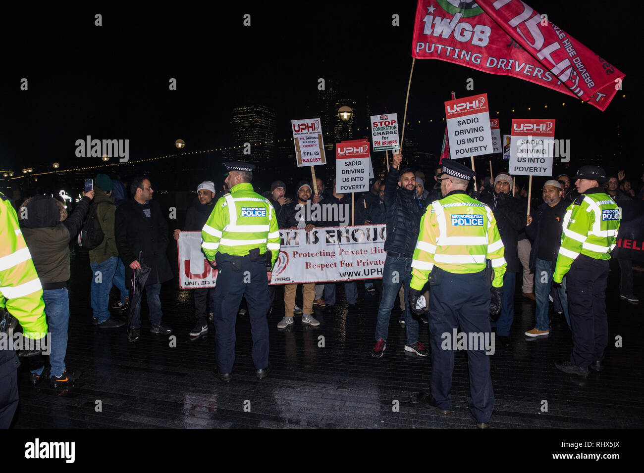 London, UK. 4th February, 2019. Hundreds of minicab drivers march to protest outside City Hall after having left their vehicles blocking London Bridge as part of a protest organised by the United Private Hire Drivers (UPHD) branch of the Independent Workers Union of Great Britain's (IWGB)  following the introduction in December of congestion charges for minicabs. Credit: Mark Kerrison/Alamy Live News - Stock Image