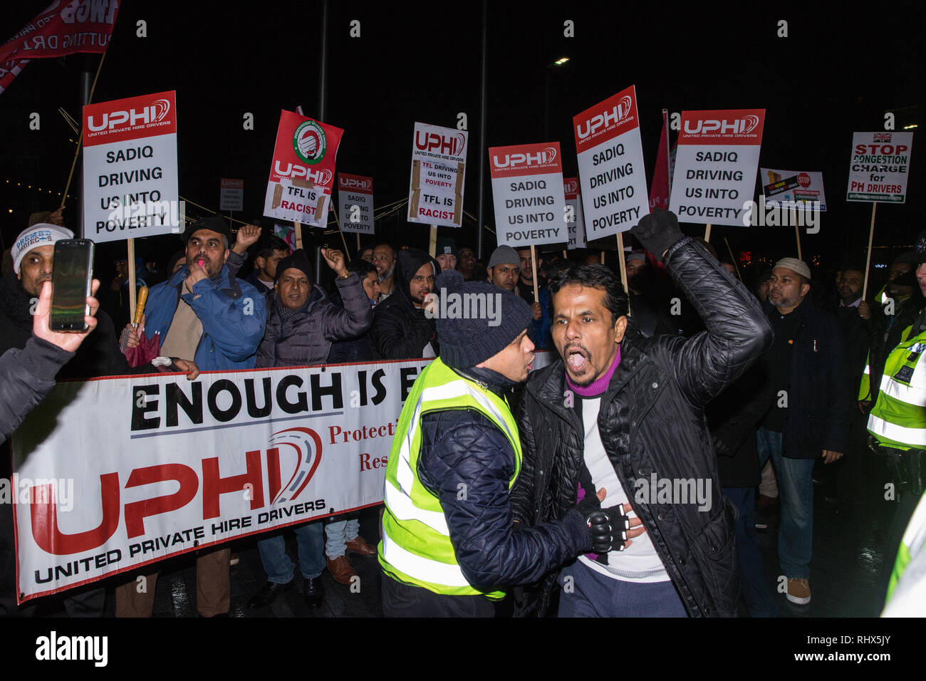 London, UK. 4th February, 2019. Hundreds of minicab drivers protest outside City Hall after having left their vehicles blocking London Bridge as part of a protest organised by the United Private Hire Drivers (UPHD) branch of the Independent Workers Union of Great Britain's (IWGB)  following the introduction in December of congestion charges for minicabs. Credit: Mark Kerrison/Alamy Live News - Stock Image