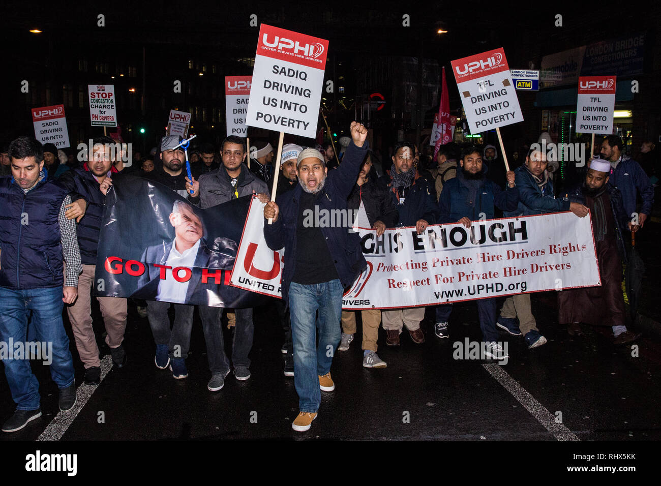 London, UK. 4th February, 2019. Hundreds of minicab drivers march around Southwark after having protested outside City Hall and having left their vehicles blocking London Bridge as part of a demonstration organised by the United Private Hire Drivers (UPHD) branch of the Independent Workers Union of Great Britain's (IWGB)  following the introduction in December of congestion charges for minicabs. Credit: Mark Kerrison/Alamy Live News - Stock Image