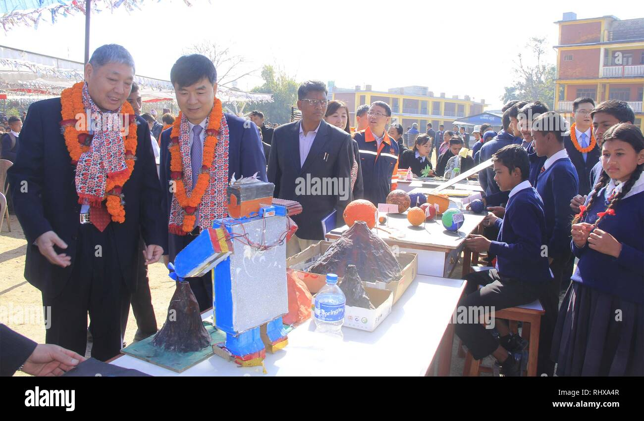 Pokhara, Nepal. 4th Feb, 2019. Representatives of China CAMC Engineering Co. Ltd visit an exhibition at Kalika Secondary School and Public College in Pokhara, Nepal, Feb. 4, 2019. The Chinese company made a donation of Rs one million (about 9,000 U.S. dollars) to the school, for students from poor families. China CAMC Engineering Co. Ltd is the contractor of the Pokhara International Airport, which is being built in the tourism hub Pokhara. Credit: Krishna Mani Baral/Xinhua/Alamy Live News - Stock Image