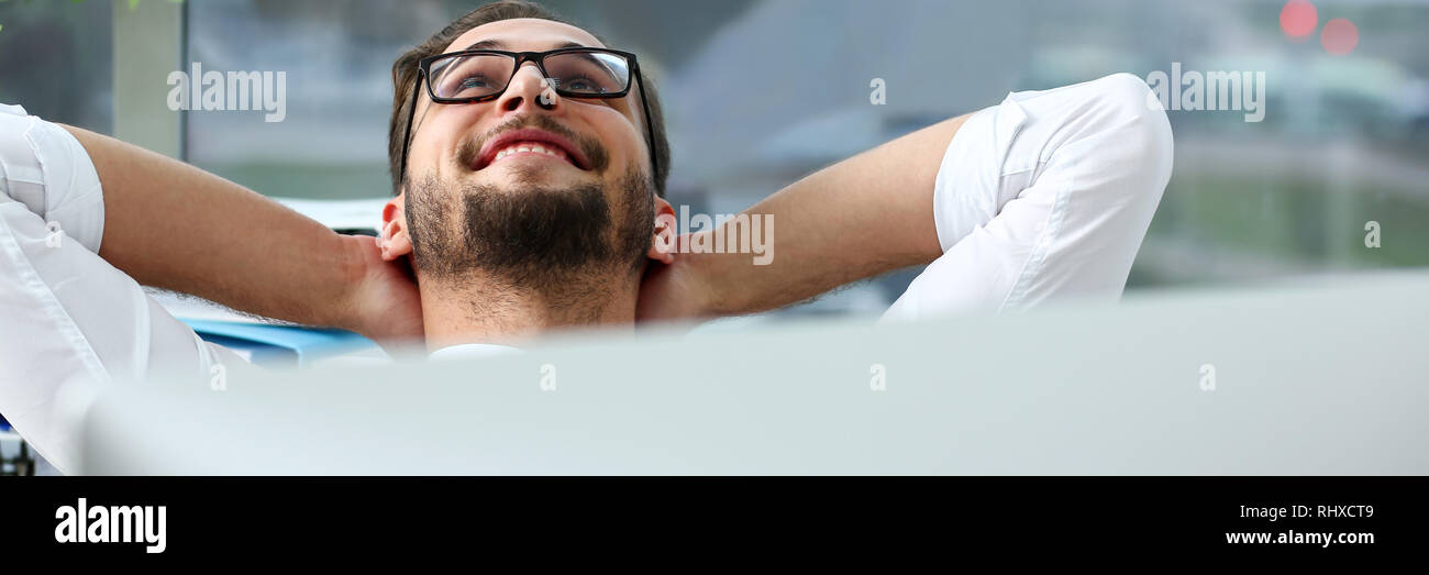 Handsome smiling bearded adult clerk person arms crossed - Stock Image