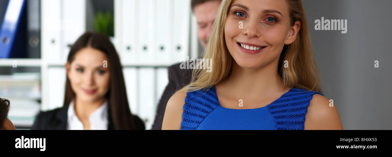 Beautiful smiling clerk girl wearing blue sundress Stock Photo