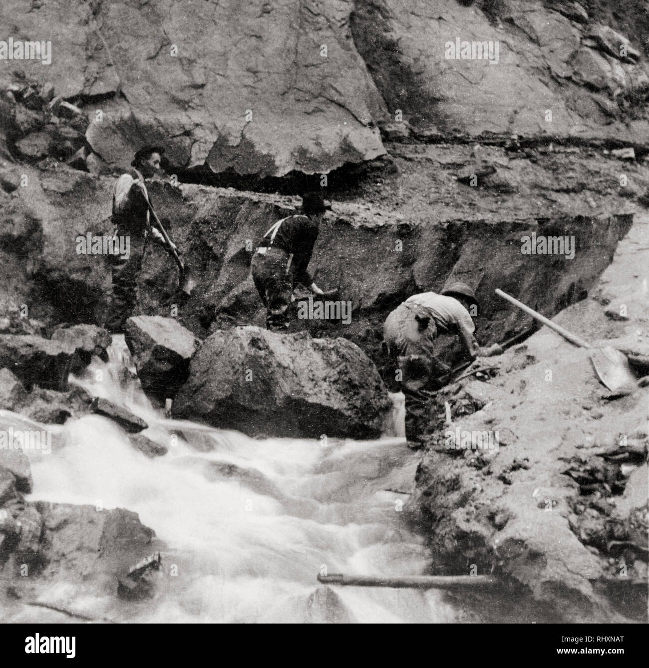 Gold Miners at Work, Alaska in 1898, showing hydraulic mining in summer possibly at the base of a glacier - Stock Image