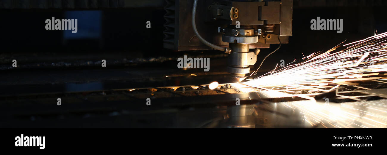 Sparks fly out machine head for metal processing - Stock Image