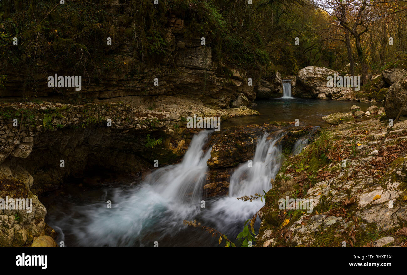 Chrousia Stream between Sirrako & Kalarrites Villages with the ruined Watermil,the Kouiasas Bridge,the stone Fountains,& stone Bridges over the stream - Stock Image