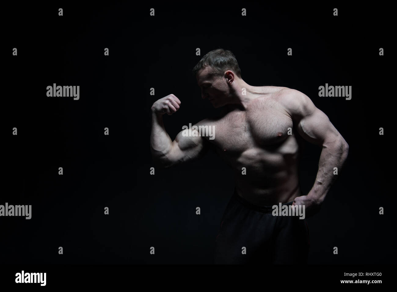 anabolic steroids. man show muscle biceps after using anabolic steroids. anabolic steroids for muscular body. anabolic steroids for bodybuilder isolated no black, copy space. Huge possibilities Stock Photo