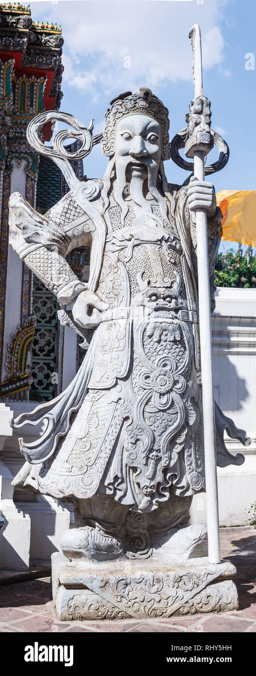 Lan Than (Chinese Rock Giants) with weapons represent noble warriors in Chinese opera-style garment in Wat Pho, Bangkok, Thailand. Chinese Stone Balla - Stock Image
