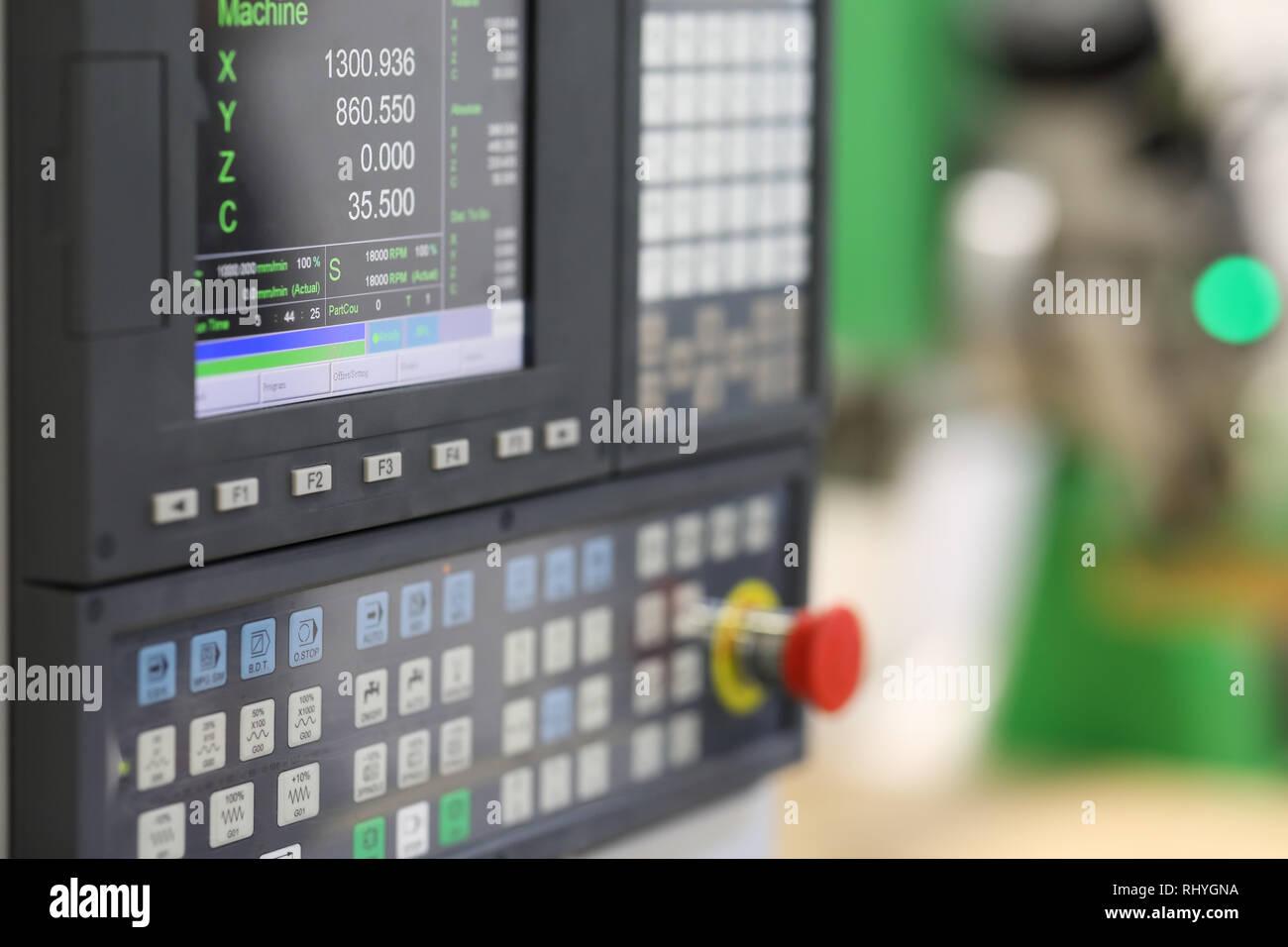 CNC control panel of lathe machine. Selective focus. - Stock Image