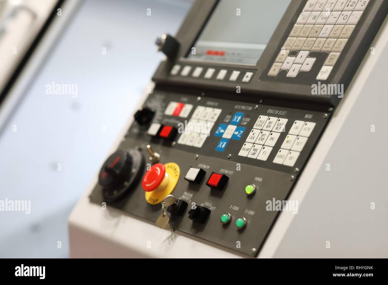CNC control panel of metalworking lathe machine. Selective focus. - Stock Image